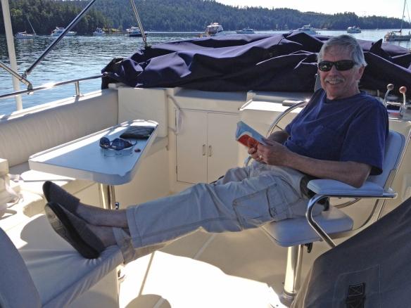 Jim reading on flybridge
