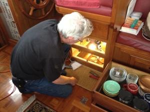 Jim drilling holes to reinstall WiFi bridge.