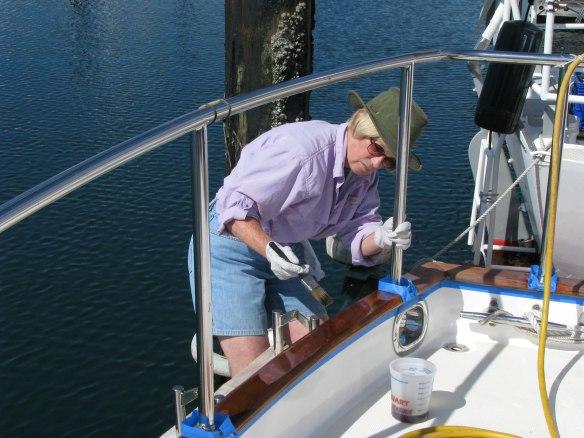 Alice varnishing stern cap rail