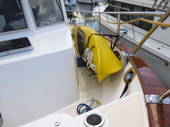 kayak stowed on deck