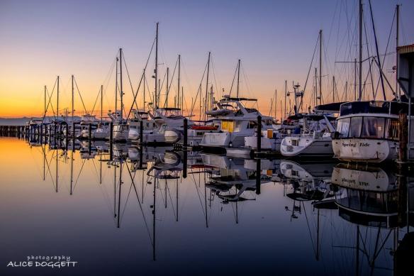 Boat reflections at Anacortes Marina